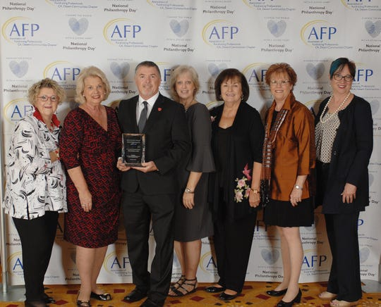 (left to right) Eileen Packer, Paula Kennedy, OUTSTANDING FUNDRAISING PROFESSIONAL Tim Evans, CFRE, Event Co-chair Judi Olivas, Event Co-chair Gailya Brown, Sarah G. Clapp, President of the Association of Fundraising Professionals CA, Desert Communities Chapter, and Awards Chair Angela Allen.