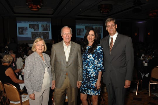 (left to right) Lorraine Brinton and Dr. James Brinton, last year's National Philanthropy Day Honorees, Kristen Shalhoub, and Walter Mueller of Olive Crest.