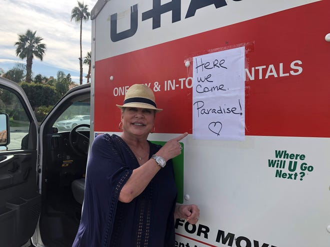 Sian Thiessen, 55, a medical laser technician, points to the sign on the side of a U-Haul carrying donated items for victims of the Camp Fire.