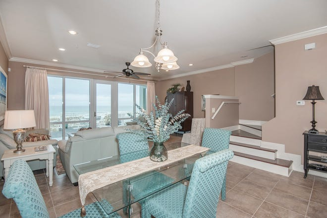 439 Fort Pickens RoadThe living area is open and bathed in natural light.