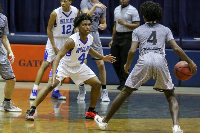 Washington's Thialan Truitt defends against Navarre's Loius Carter in the preseason basketball jamboree at Escambia High School on Tuesday, November 20, 2018.