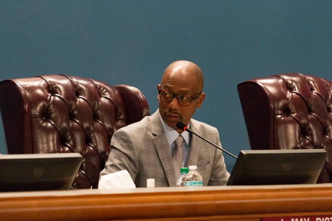 Escambia County Commissioner Lumon May speaks at a meeting on Nov. 20, 2018