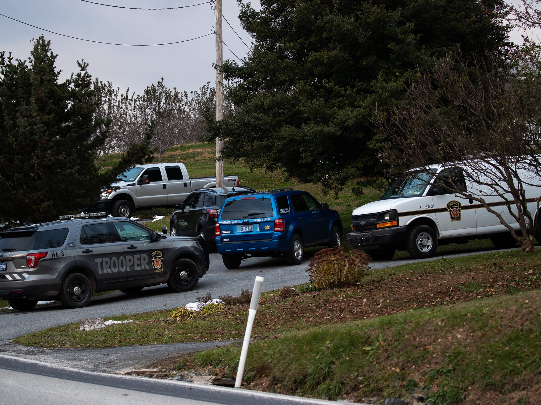 State Police and the Adams County Coroner investigate a suspicious death on the 100 block of Peach Glen-Idaville Road, Wednesday, Nov. 21, 2018, in Huntington Township.