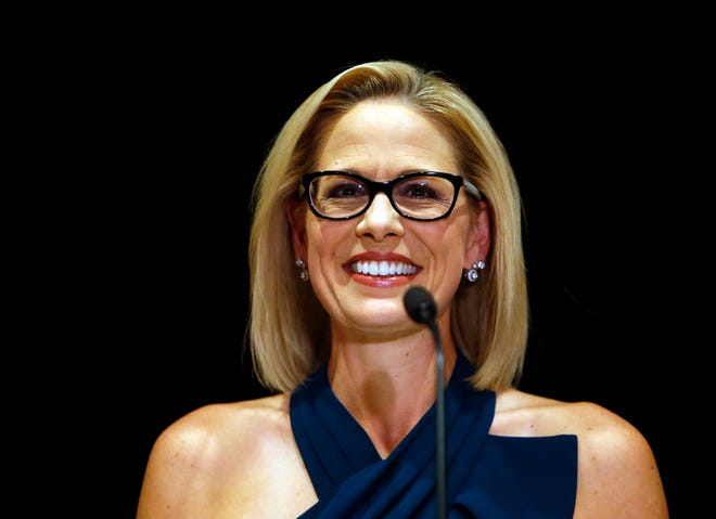 U.S. Sen.-elect Kyrsten Sinema, D-Ariz., smiles after her victory over Republican challenger U.S. Rep. Martha McSally, Monday, Nov. 12, 2018, in Scottsdale. Sinema won Arizona's open U.S. Senate seat in a race that was among the most closely watched in the nation, beating McSally in the battle to replace GOP Sen. Jeff Flake.