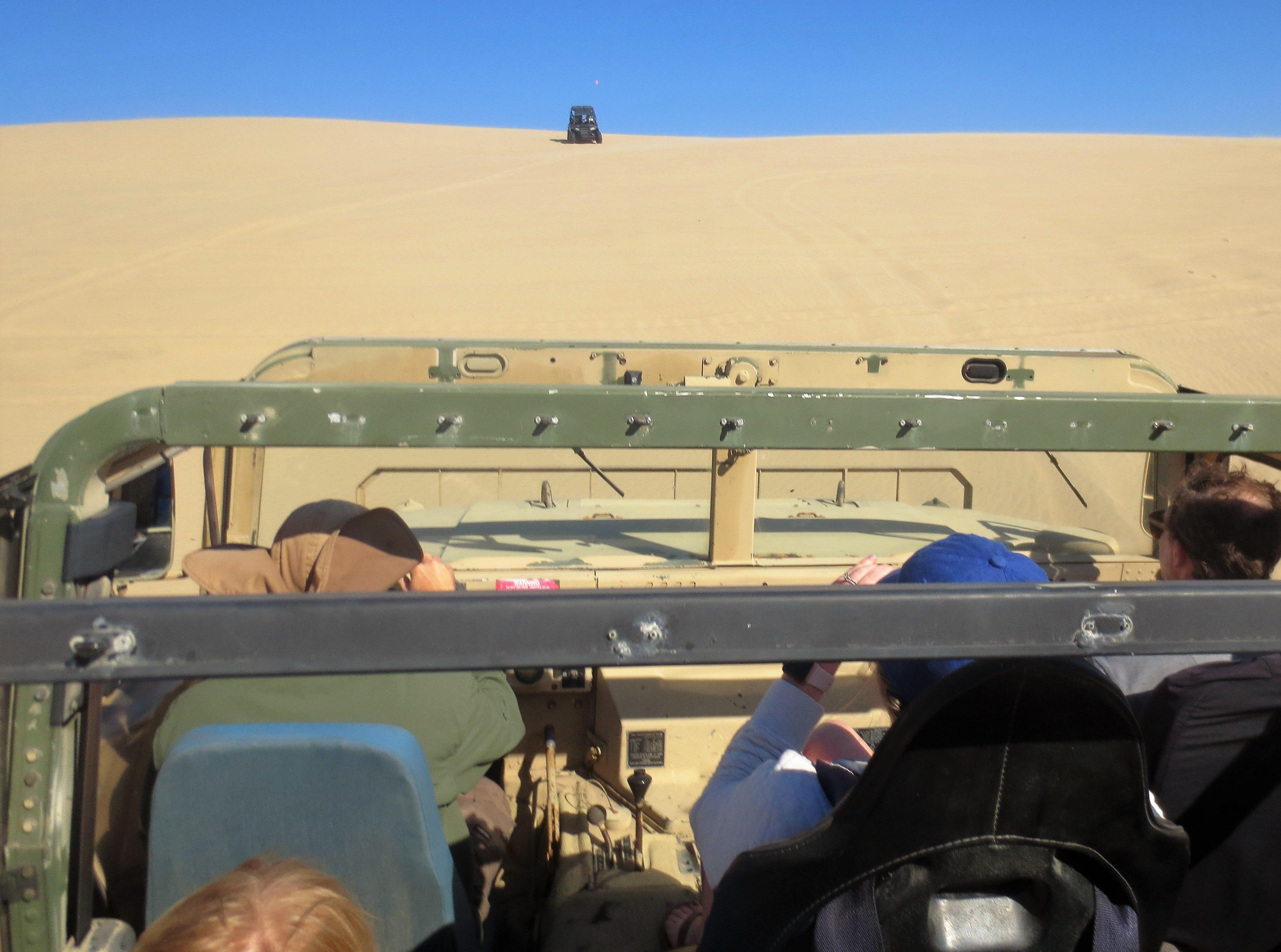 Humvees traverse the dunes near Pismo Beach in San Luis Obispo County.