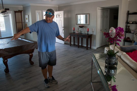 David Dronning explains where his home's main plumbing line was collapsed. Within days of closing, the collapsed line caused flooding in the house.