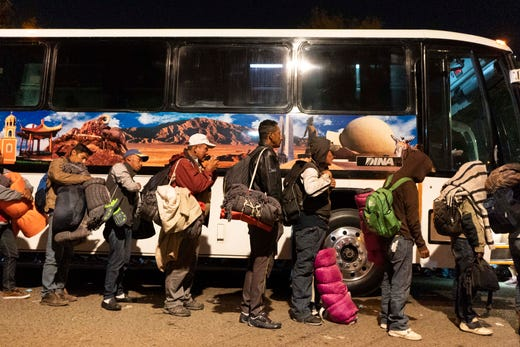 Several charter buses arrive just past midnight Nov. 20, 2018, and in the early hours Nov. 21 to the Unidad Deportiva Benito Juarez, the sports complex that city opened up as a makeshift shelter in Tijuana, Mexico. It's unclear exactly how many migrants had traveled on board. But inside, 3,000 other migrants had been arriving in Tijuana since last week. Overcrowded shelter, with minimal options on space with little other choices, many of them settled into the cold and damp field of the outdoor baseball stadium.