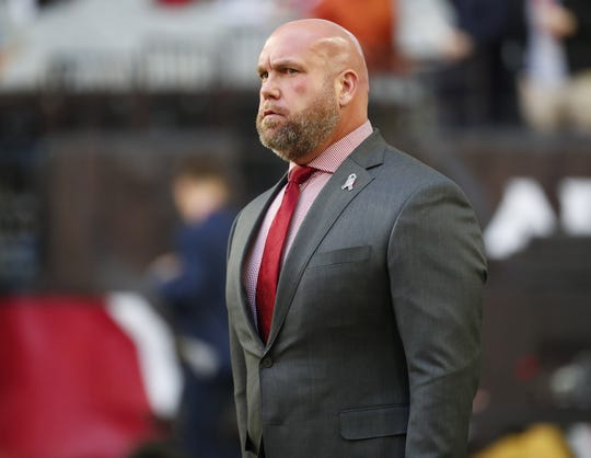 Cardinals general manager Steve Keim watches his team warm up before a game against he Raiders on Nov. 18 at State Farm Stadium.
