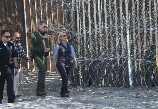 Homeland Security Secretary Kirstjen Nielsen toured with Chief Patrol Agent Rodney S. Scott, at the U.S.-Mexico border fence in San Diego on Nov. 20, 2018.