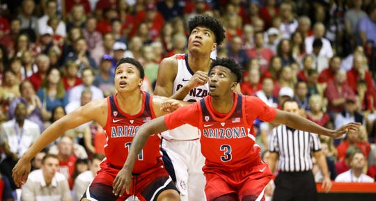 Ira Lee and Dylan Smith #3 of the Arizona Wildcats block out Rui Hachimura #21 of the Gonzaga Bulldogs during a free throw attempt during the first half of the game at the Lahaina Civic Center on November 20, 2018 in Lahaina, Hawaii.