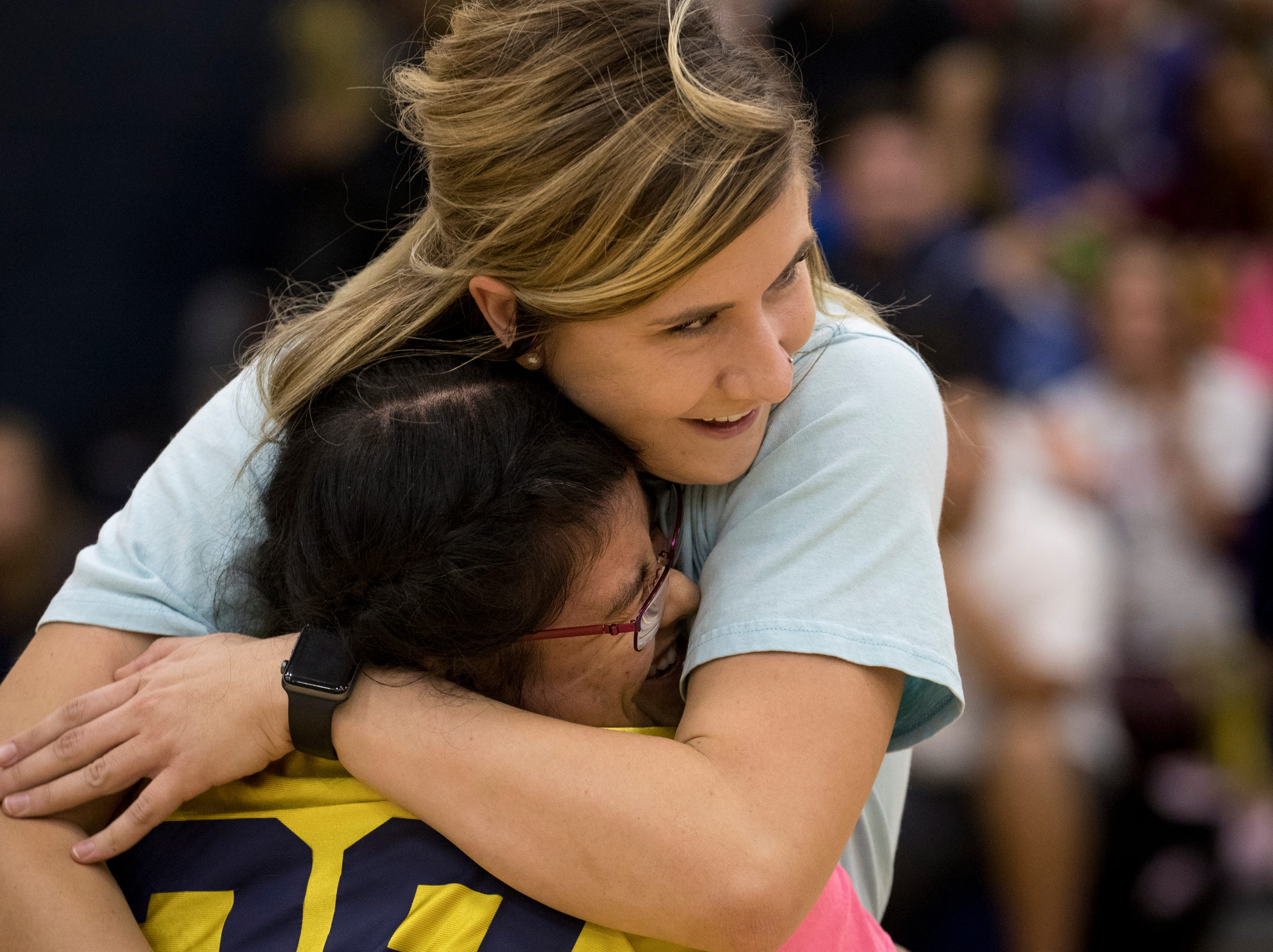 Jessica Avena (Class of 2012) is reunited with her Unified Pride partner, Halie Claiborne, during an assembly Nov. 8, 2018, at Raymond S. Kellis High School in Glendale.