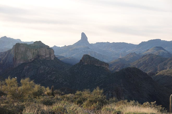 Battleship Mountain (left) and and Weavers Needle can be seen from the  Boulder Canyon Trail.