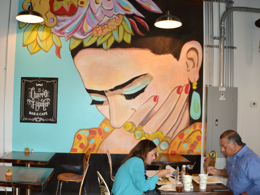 El Charro Hipster Bar & Cafe is full of original art, including an oversize mural of Frida Kahlo painted by members of the Peralta family.