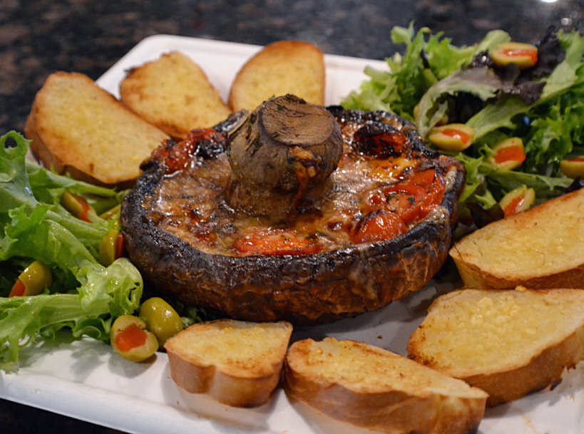 The Portobello Hipster ($10.50) is a shareable small plate featuring a large portobello mushroom cap marinated in olive oil, herbs and grape tomatoes. It's served with a small salad and garlic bread.