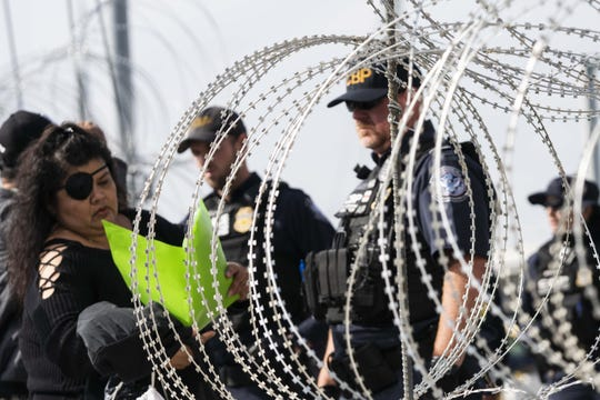 U.S. Customs and Border Protection temporarily shut down the San Ysidro port of entry in San Diego-Tijuana, to install additional fortifications for the migrant caravan in Tijuana, Baja California, Mexico, on Nov. 19, 2018. The lanes reopened after about three hours.