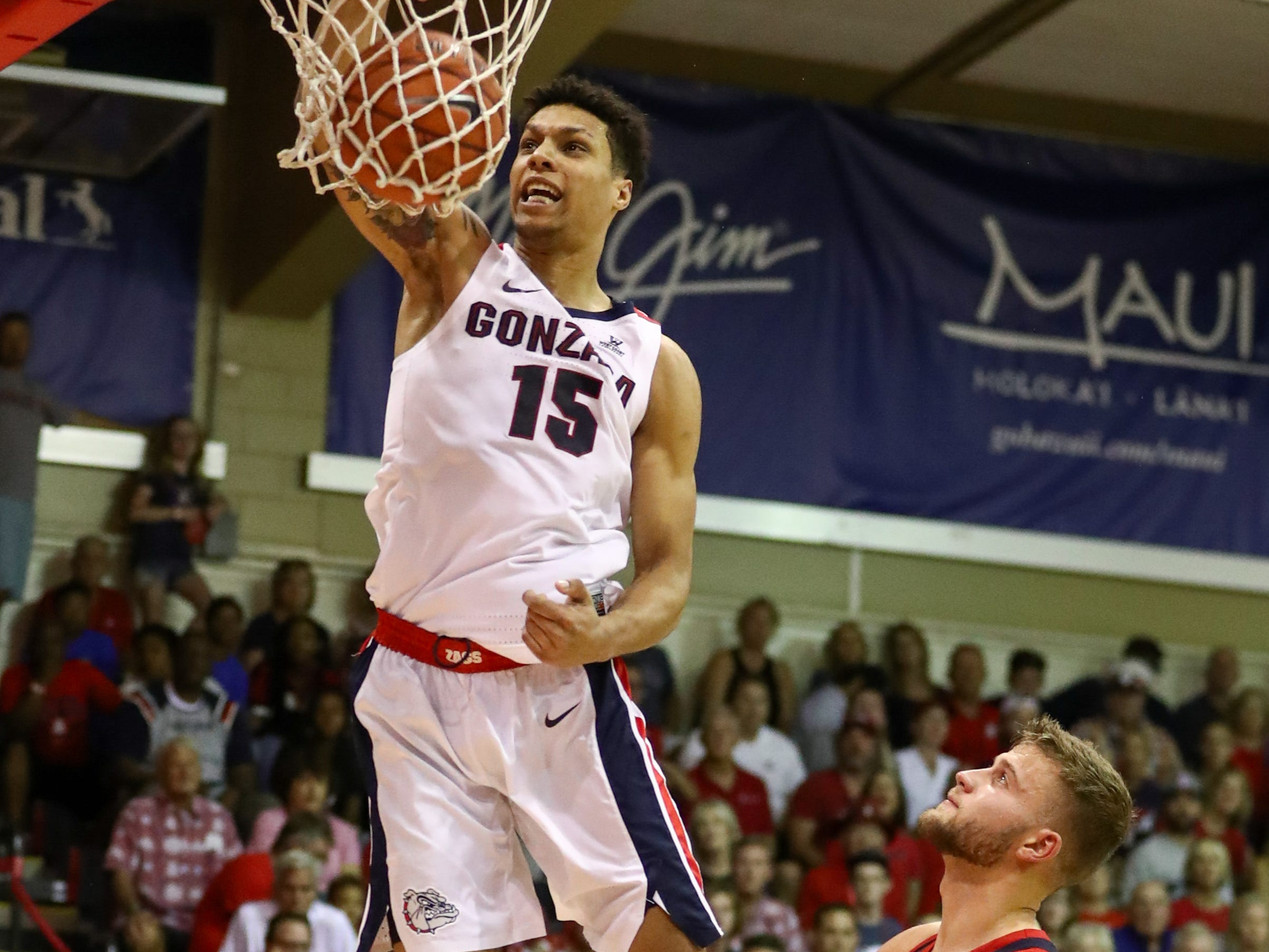 Ryan Luther #10 of the Arizona Wildcats looks on as Brandon Clarke #15 of the Gonzaga Bulldogs throws down a dunk during the first half of the game at the Lahaina Civic Center on November 20, 2018 in Lahaina, Hawaii.