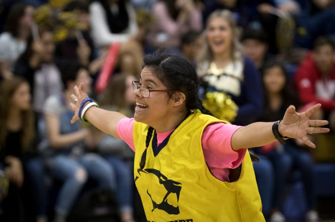 Jessica Avena (Class of 2012) runs to be reunited with her Unified Pride partner during an assembly Nov. 8, 2018, at Raymond S. Kellis High School in Glendale.
