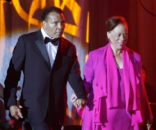Muhammad Ali is escorted onstage by his wife, Lonnie, during Celebrity Fight Night XVII at JW Marriott Desert Ridge Resort & Spa in Phoenix on Saturday, March 19, 2011.