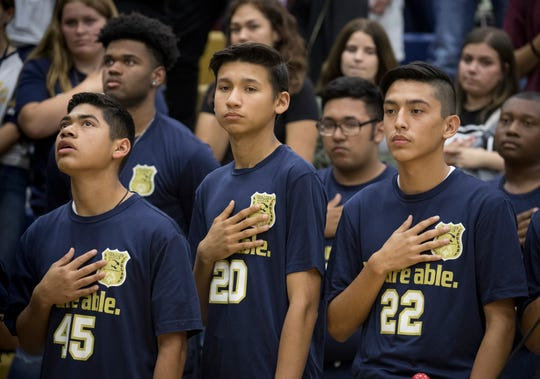 Unified Pride team members stand for the national anthem Nov. 8, 2018, at Raymond S. Kellis High School in Glendale.