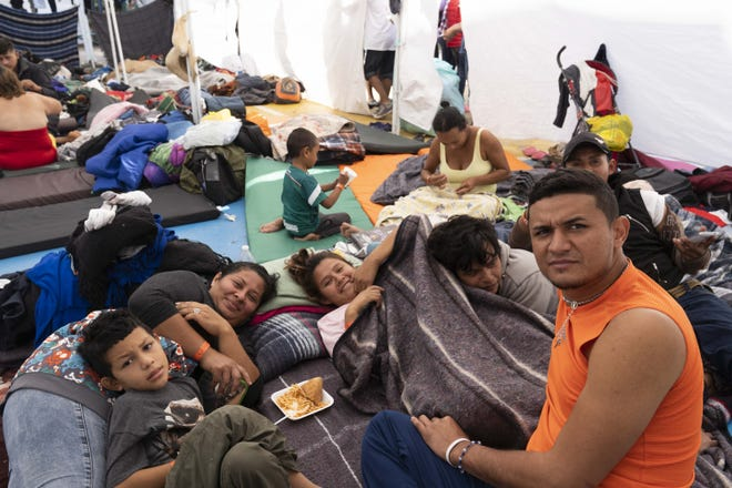 Over 2,500 mostly Central American migrants are currently staying at the Unidad Deportiva Benito Juarez, a makeshift shelter, in Tijuana, Mexico. Migrants set up camp around the baseball stadium, propping up tents using whatever materials they have available. Bathrooms and outdoor showers were installed in the outfield.