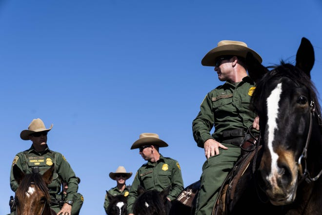 Customs and Border Protection agents patrol the U.S.-Mexico border fence in San Diego on Nov. 20, 2018.