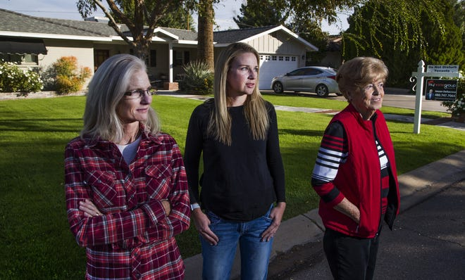 Neighbors stand outside a home being run as an Airbnb in the Royal Crest Villa community of Phoenix Tuesday, Nov. 20, 2018. From left to right are: Holly Keeble, Andrea Ditty-Pederson and Judi Murphy.