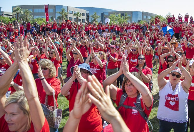 Teachers and their supporters celebrate victory in the Red for Ed movement during a gathering at Wesley Bolin Memorial Plaza at the capitol in Phoenix, Thursday, May 3, 2018. The legislature passed a bill and the governor signed it increasing education spending in Arizona.
