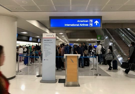 American Airlines line where travelers experienced technical difficulties at Sky Harbor Airport