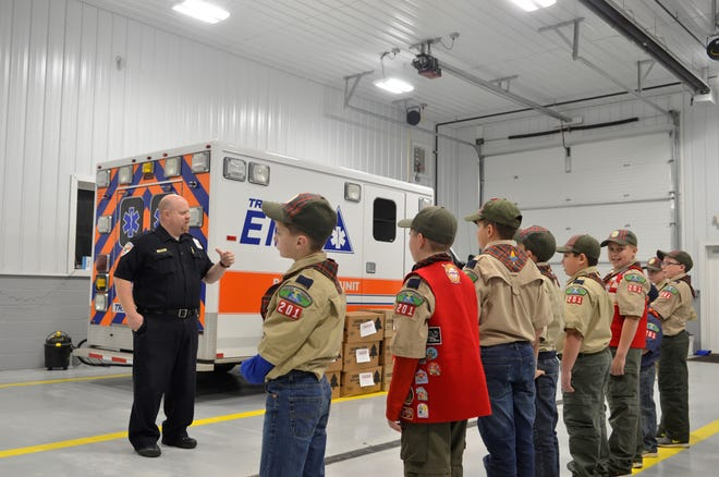 Cub Scouts with Pack 201 in Marysville dropped off cases of popcorn to Tri-Hospital EMS on Tuesday. Paramedic and field supervisor Bill Adams talked to them about first aid and showed them around the building and an ambulance.