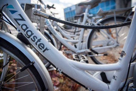 Zagster bikes are seen at the rack on the corner of Water and Military strees Wednesday, Nov. 21, 2018 in Port Huron.  Starting this weekend, the bikes will be removed from the streets for the winter.