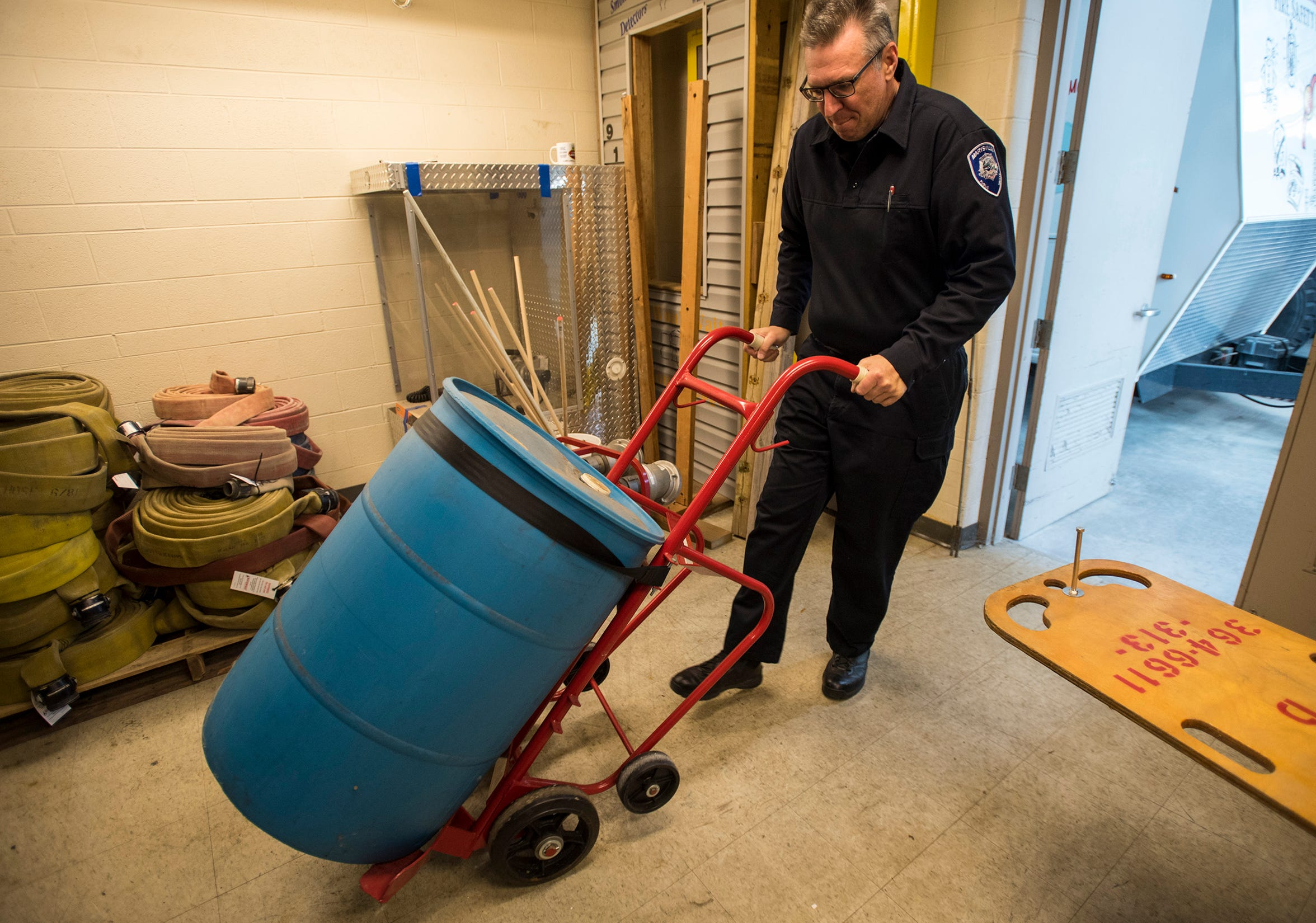 Marysville Public Safety Director Tom Konik moves a barrel  containing Class B firefighting foam containing PFAS Wednesday, nov. 21, 2018 at Marysville Fire Department. Konic says that due to the pipelines and storange tanks for flammable liquids in the city, Marysville has a greater need for the firefighting foam.