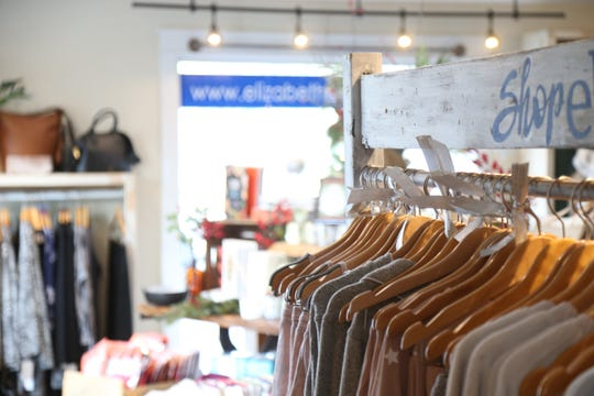 Items for sale at Elizabeth Boutique in the Arlington shopping district on November 21, 2018.