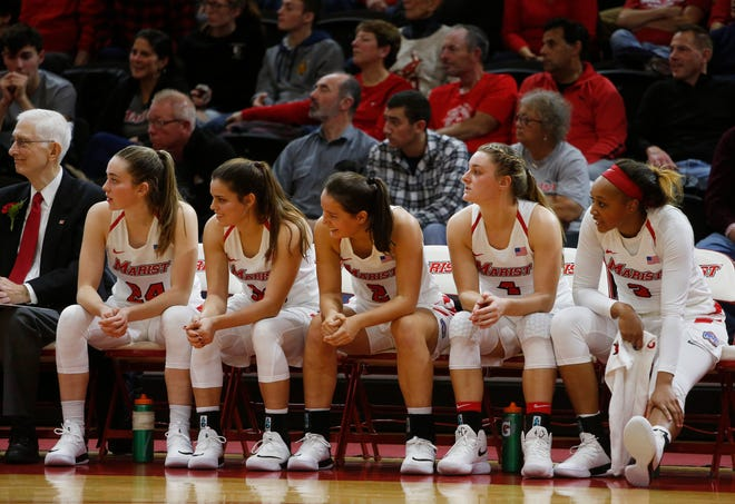 Players on the Marist College bench watching the action between the Red Foxes and Boston University on November 16, 2018.