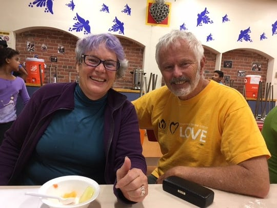 Paradise Township resident Carol Stowell (left) and David Usher (right) volunteer at Annunciation House in El Paso, Texas, helping refugees seeking asylum receive care and get connected with friends or family in the United States.