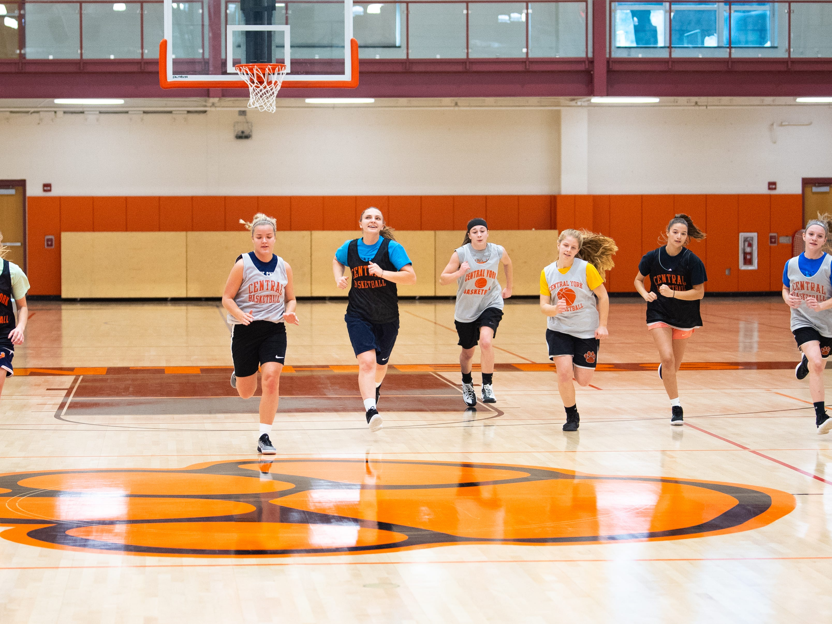 Central York girls' basketball players run during practice, Wednesday, November 21, 2018.