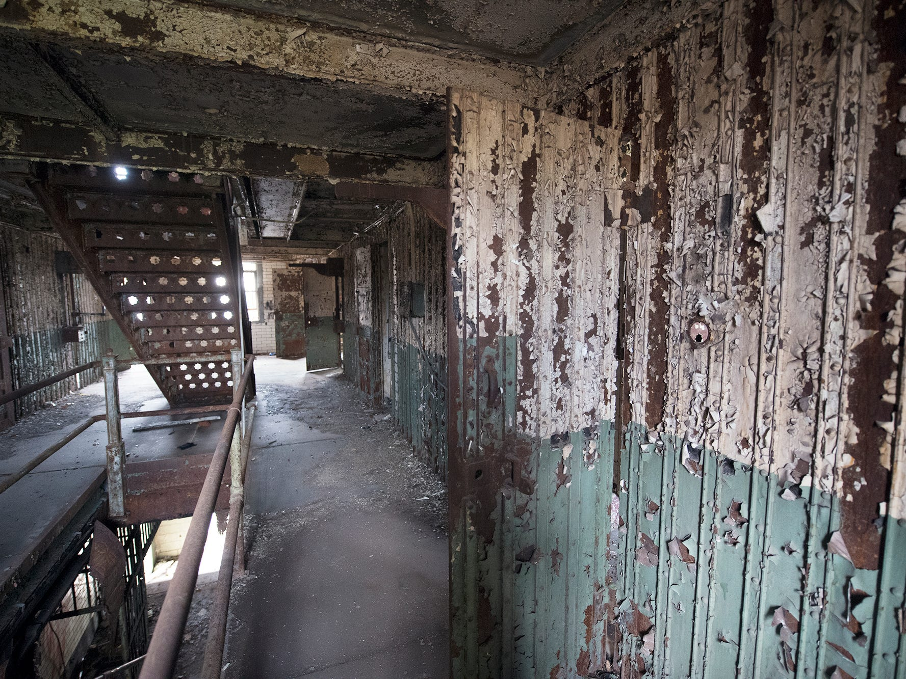 Paint peels on an upper floor inside the old York County Prison.