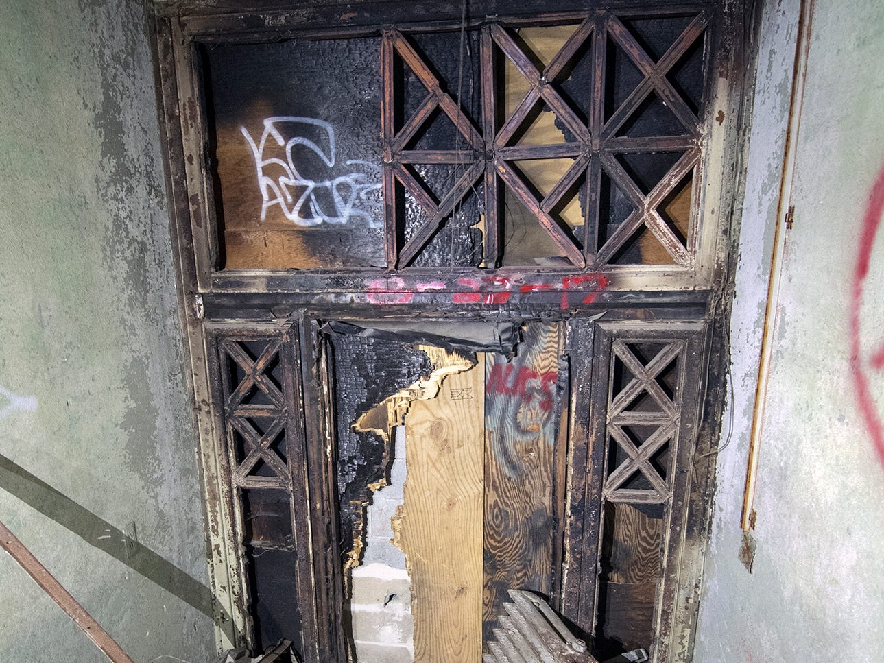 A battered side entrance inside the old York County Prison is littered with a radiator and other debris.