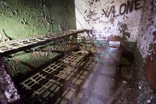 A prison cell with bunks, toilet and sink still intact sits inside the old York County Prison.