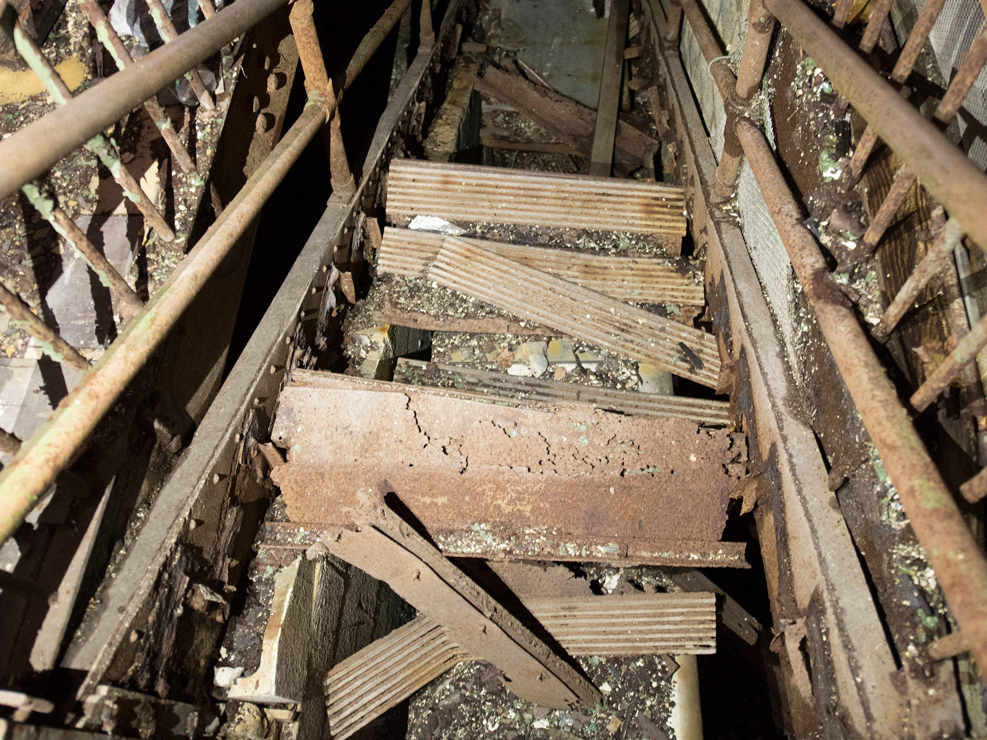 Metal stairs down to one side of the basement have deteriorated inside the old York County Prison.