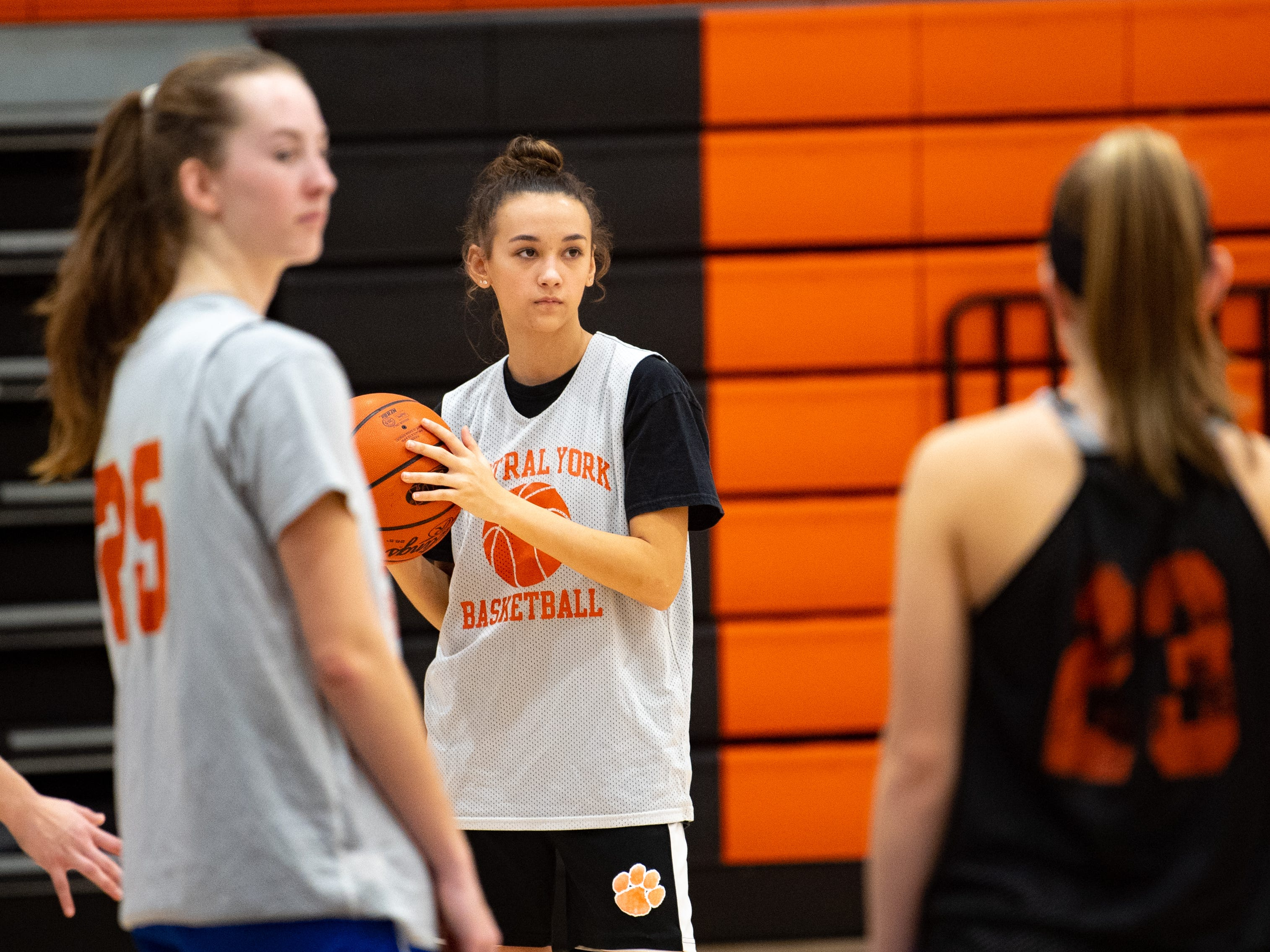 Central York girls' basketball players go over zone defense during practice, Wednesday, November 21, 2018.