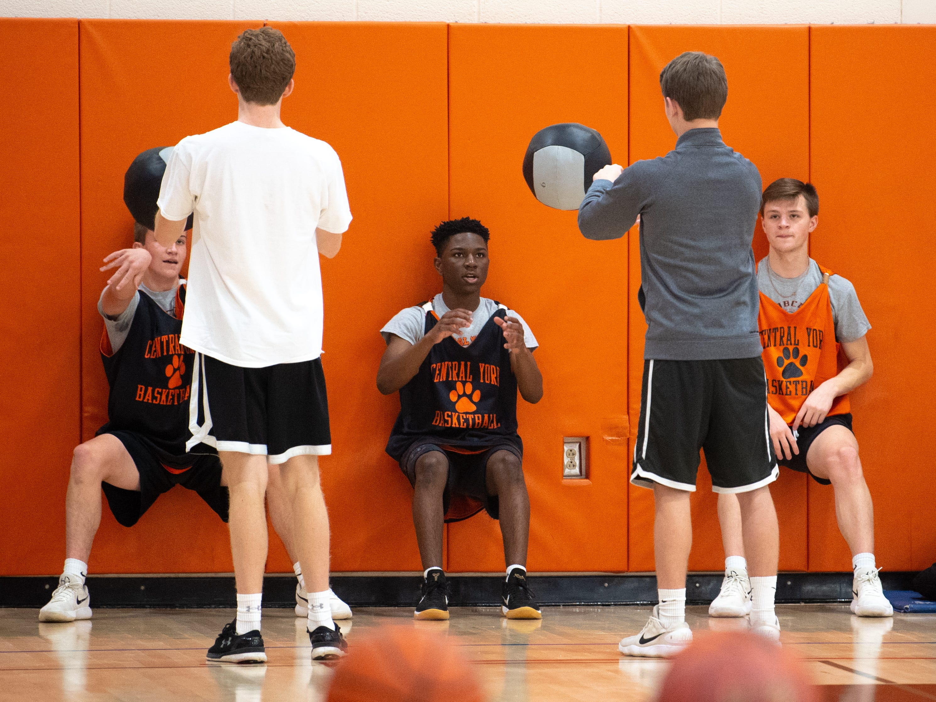 Central York boys' basketball players work on their legs during practice, Wednesday, November 21, 2018.