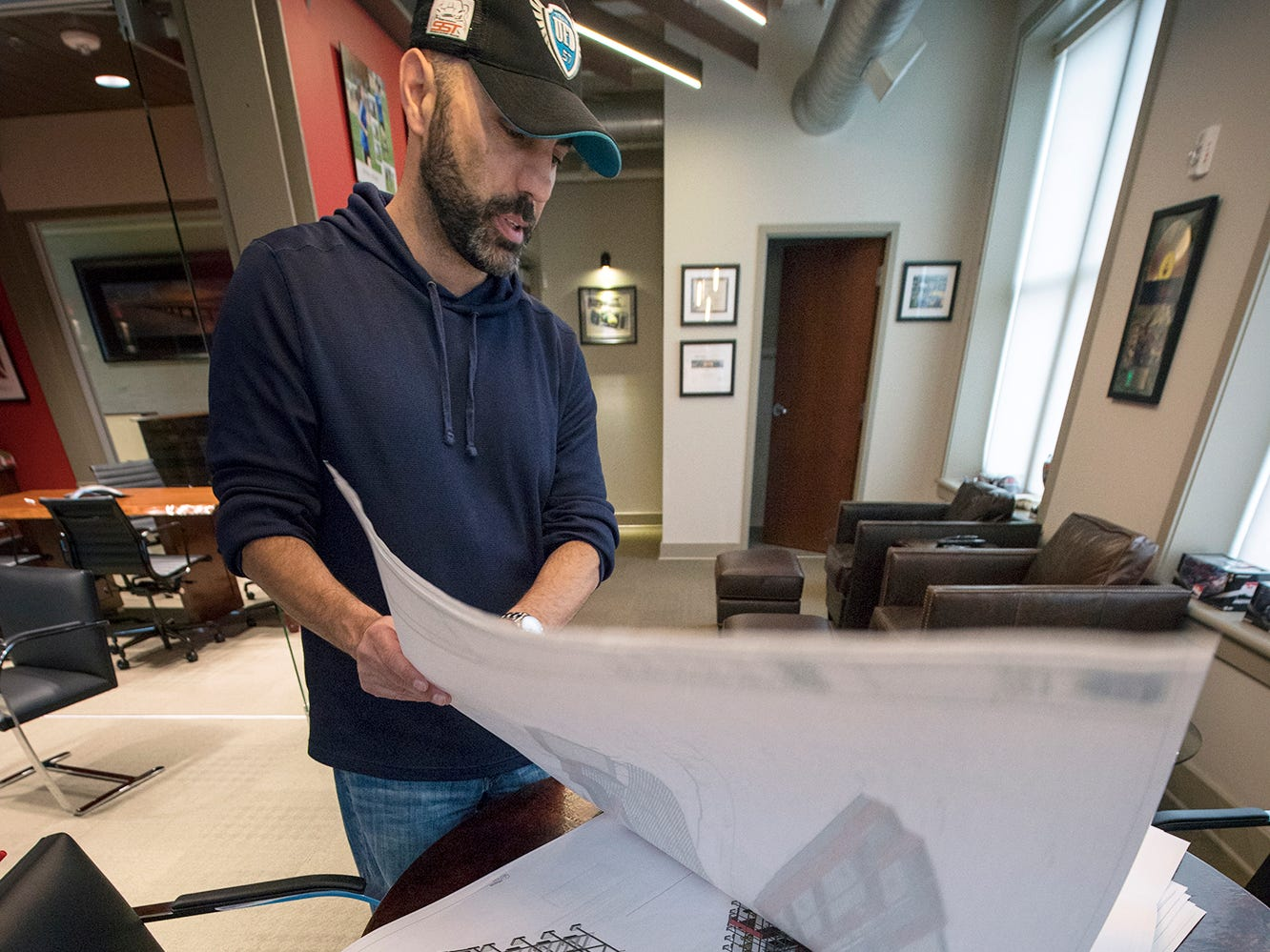 Bill Hynes, CEO of UFD, looks over artist renderings that will incorporate the old York County Prison.