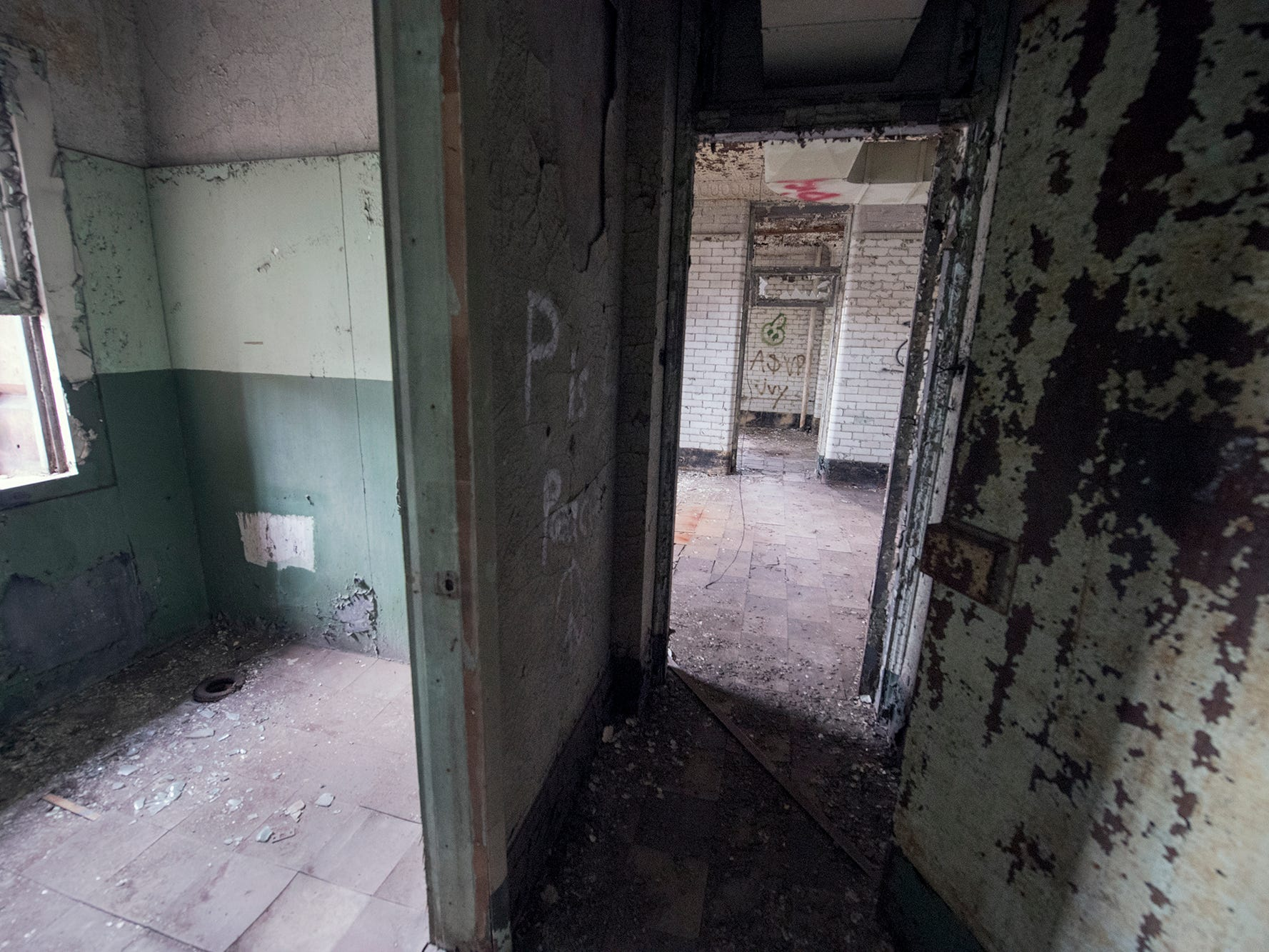 Offices crumble with years exposed to heat and cold inside the first floor of old the York County Prison.