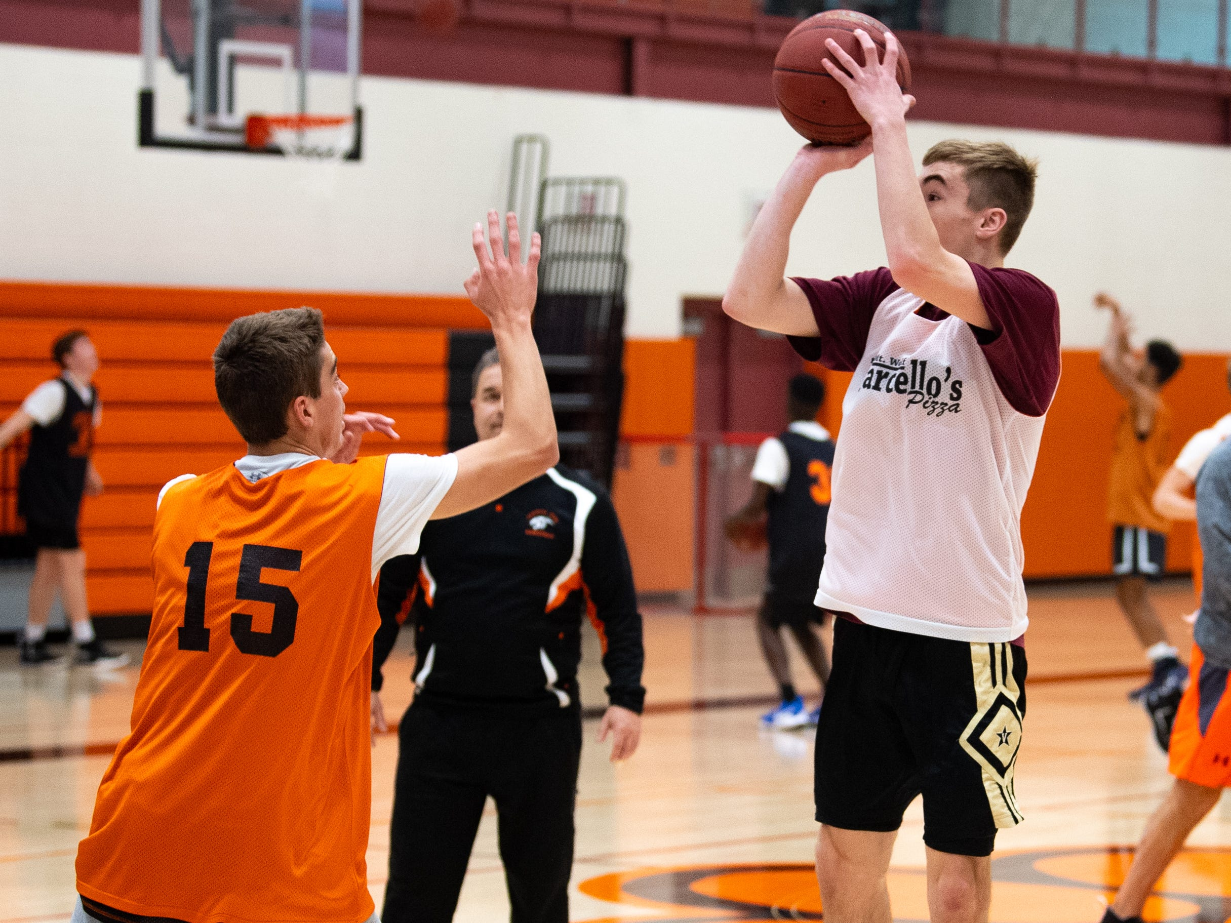 Central York boys' basketball players shoot 3-pointers during practice, Wednesday, November 21, 2018.