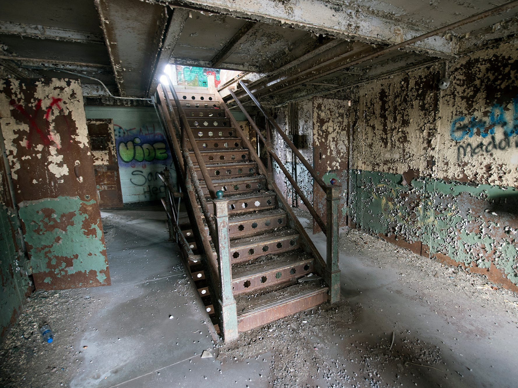 The central staircase rises up through the inside of the old York County Prison.