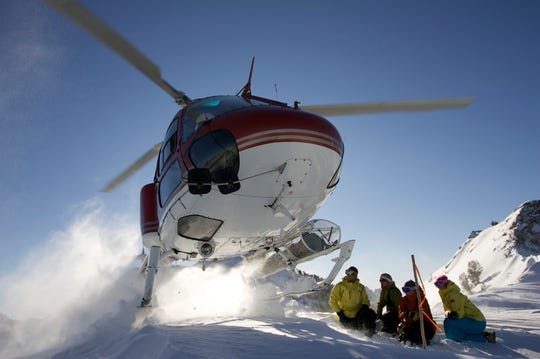 Skiers are dropped off for a run in the Ruby Mountains of eastern Nevada by a copter from Ruby Mountain Heli.