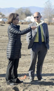 Human Services Director Edrie LaVoie (left) and County Manager Jeff Page talk after the groundbreaking ceremony. LaVoie was instrumental in getting the senior center project going.