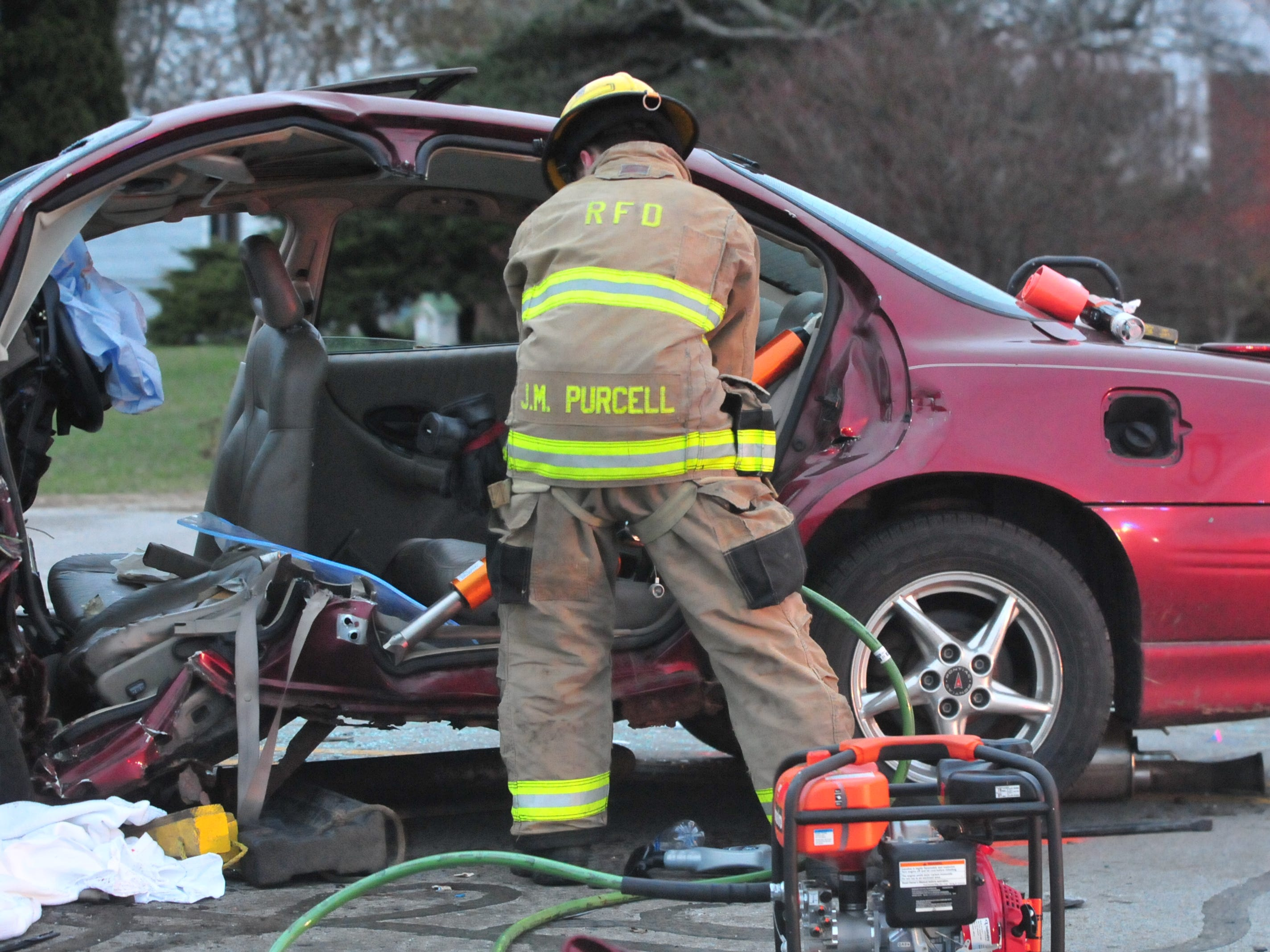 Richmond Fire Department personnel extricated the driver from a Pontiac Grand Prix following a head-on collision Tuesday on Salisbury Road.