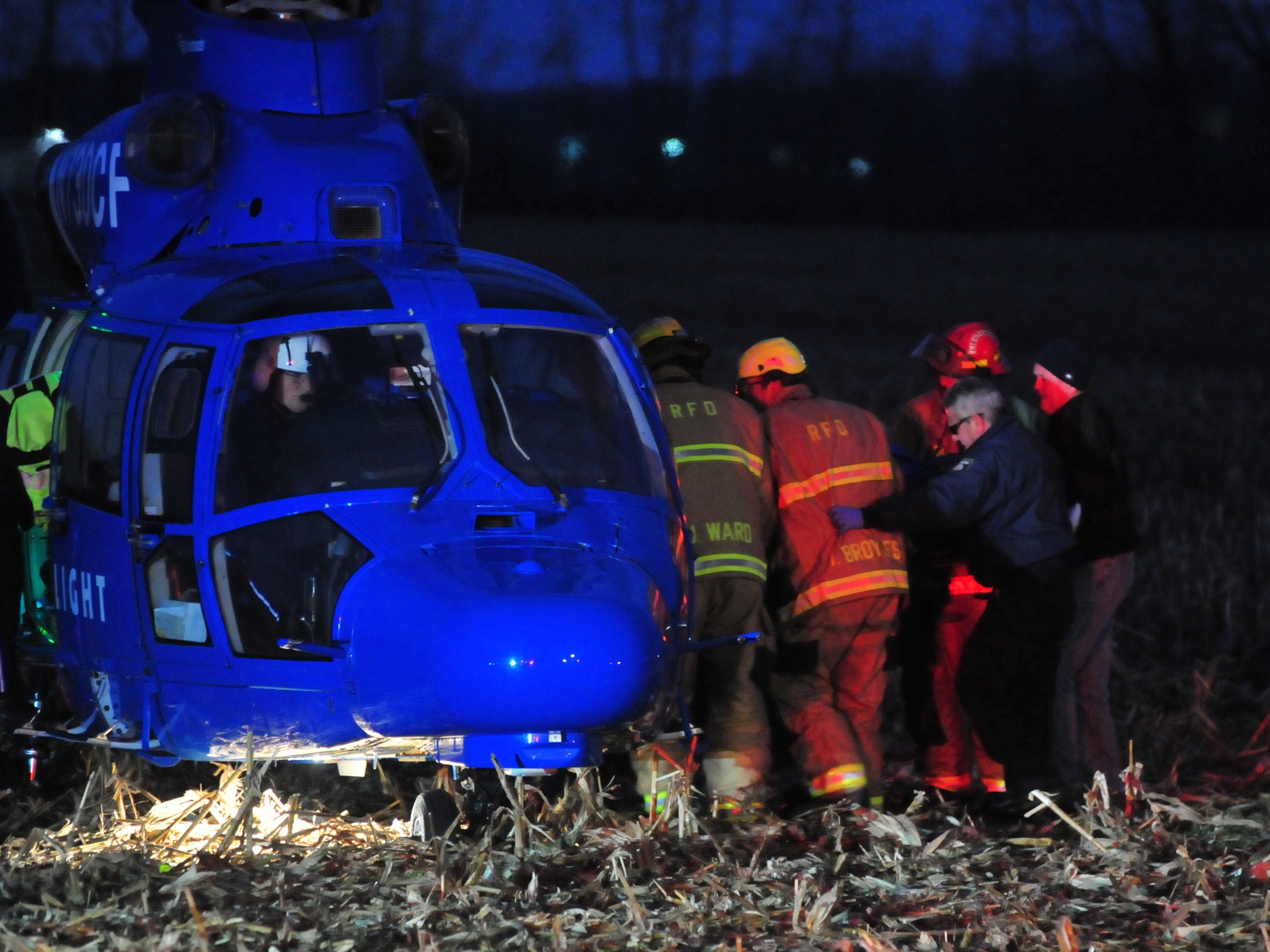 A patient is loaded into a Careflight helicopter Tuesday in a cornfield west of Salisbury Road.
