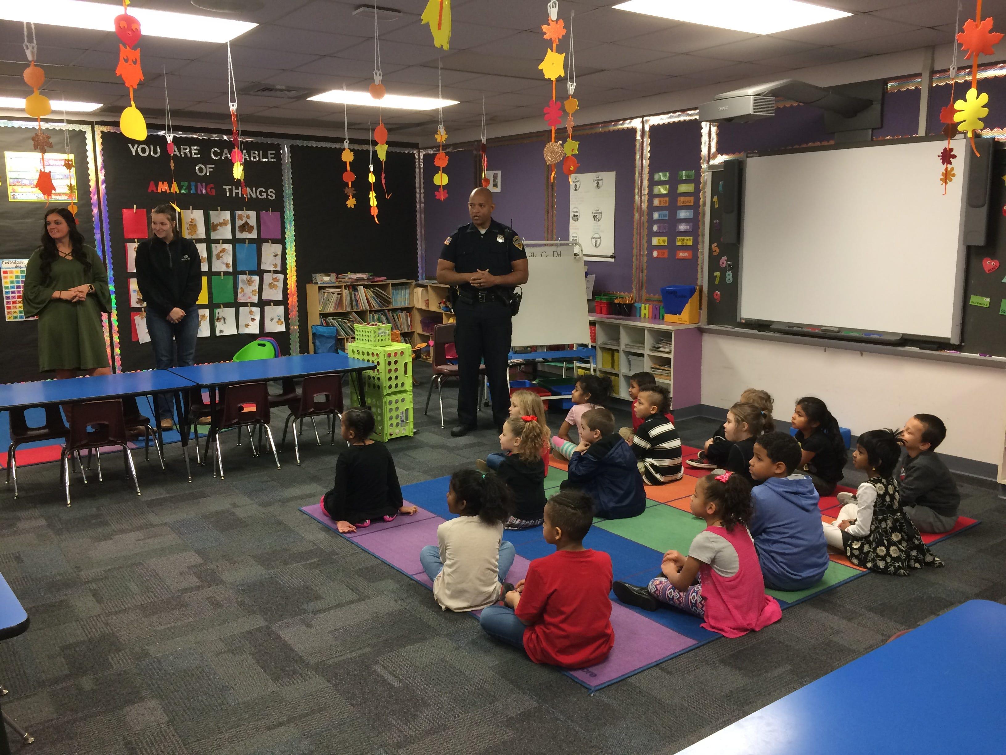 Officer Tim Davis talks to a Vaile Elementary kindergarten class Tuesday.